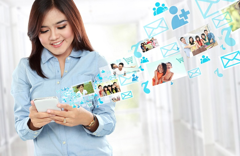 Portrait smiling beautiful woman using mobile phone, text messaging, social media, on mobile phone