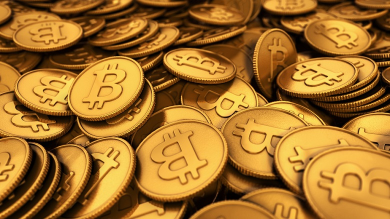 3D rendered close up illustration of a large group of golden Bitcoins with depth of field blur