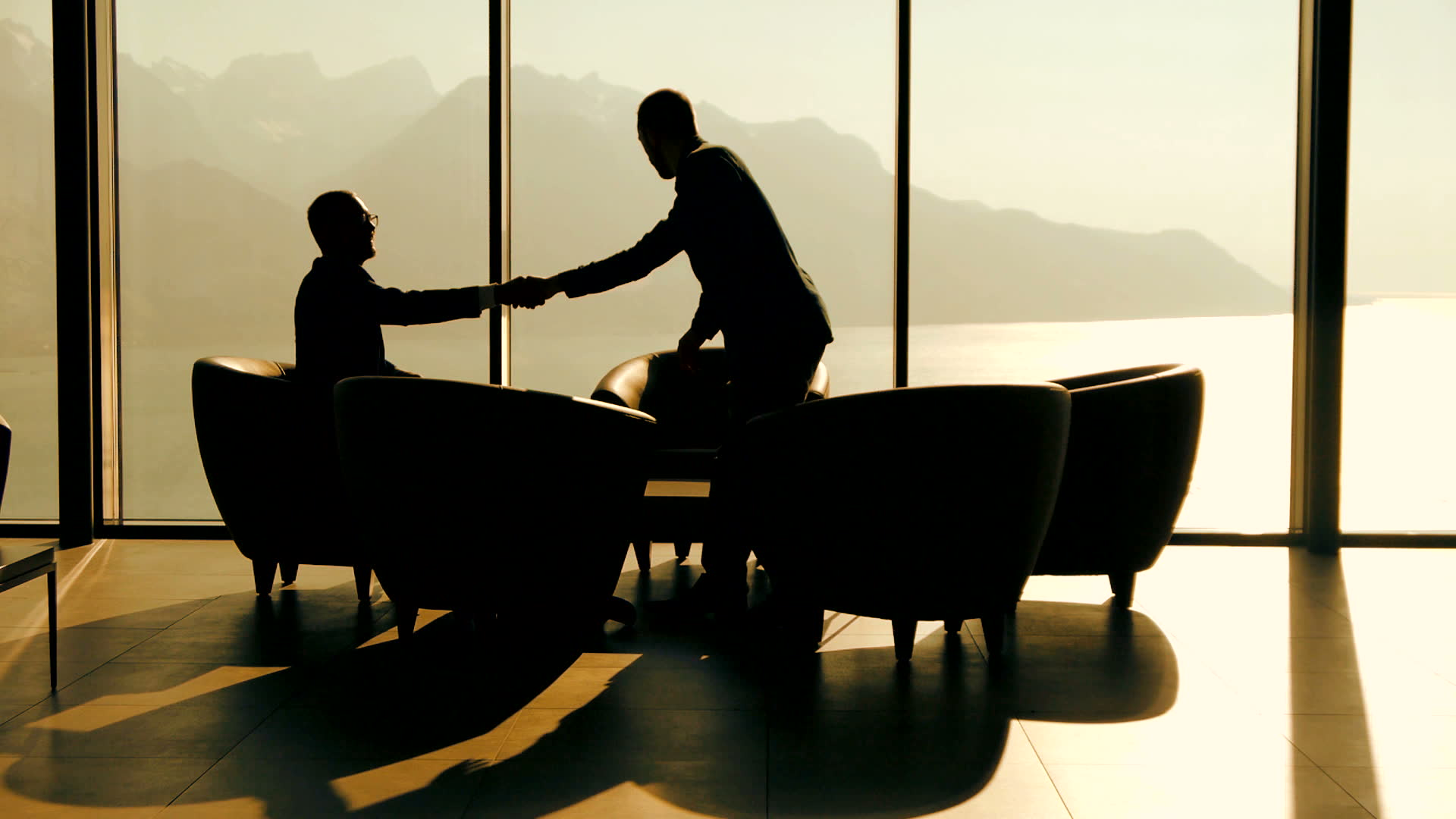 stock-footage-business-meeting-businessman-having-a-conversation-discussion-talking-silhouette-business